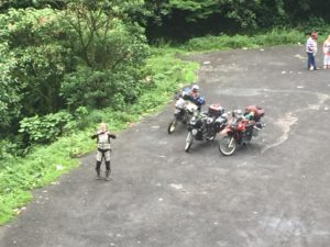Our friend Chris with the bikes (photo taken from the top of the tunnel)